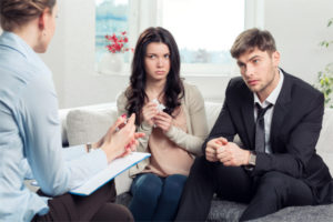 Young couple in clinical & family therapy